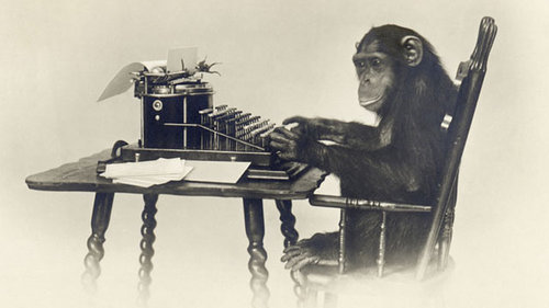 A monkey sitting at a typewriter making an artist statement