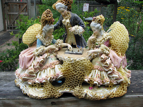 sculpture of three people made from bee's wax honeycomb