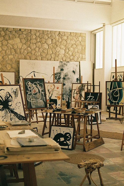 Art Studio Of Joan Miro With Many Paintings Resting On Aisles