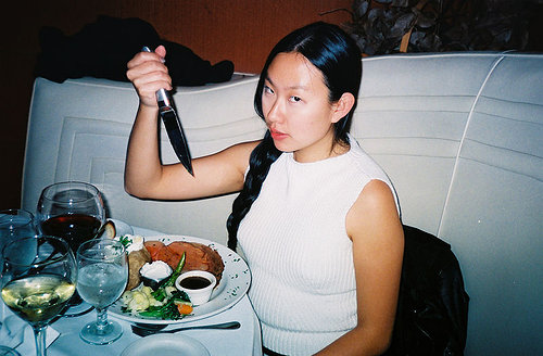 photo of asian woman holding a knife
