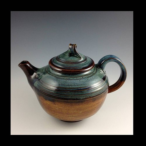 ceramic teapot with green and red glazing