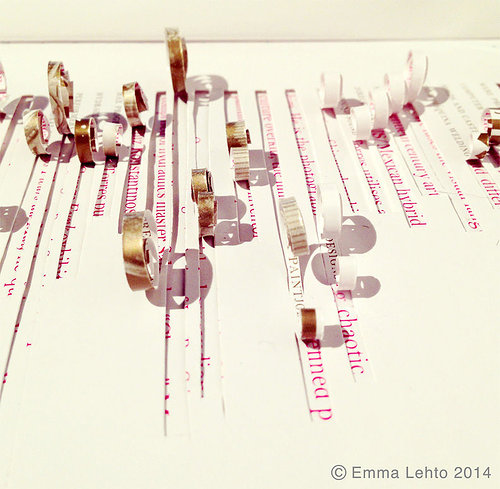 detailed photo of book art with sentences cut out