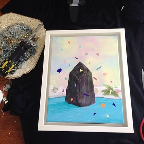 small painting of a black shape with confetti in the foreground