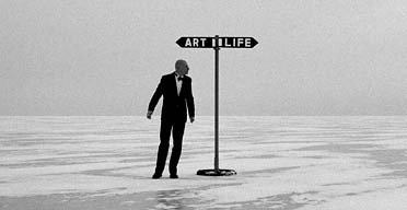 Man and a sign that says art or life