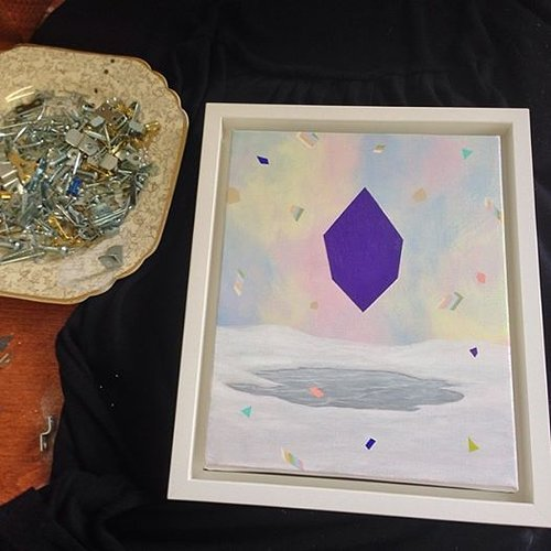 painting of winter scene with purple geometric shape in the middle surrounded by confetti