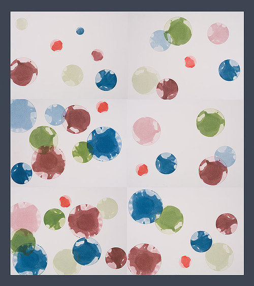 ink blots on white paper using green, red, and blue ink