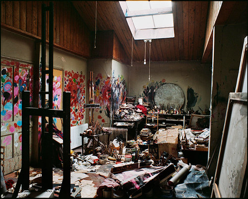 messy artist studio of francis bacon with paintings on the wall and clutter and garbage everywhere