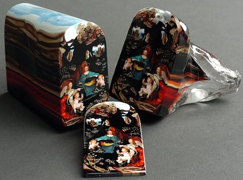 glass sculpture cut in half with a picture inside