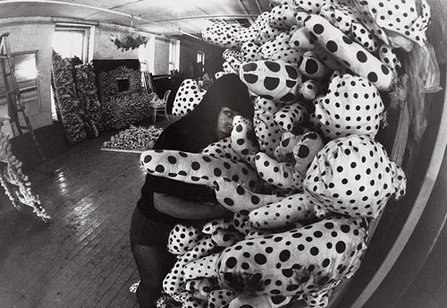 woman with stuffed animals and dots