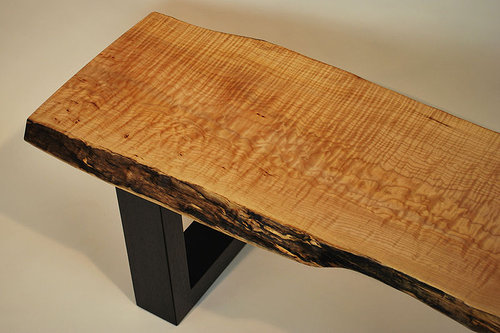 An utra-modern solid wood bench