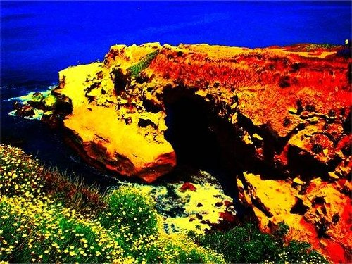 A photo of a coastal cliff with the colours digitally edited