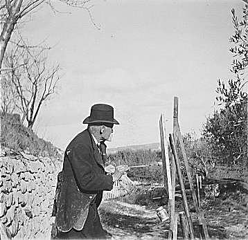 Paul Cézanne painting outdoors