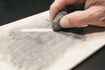 person erasing an area of a drawing