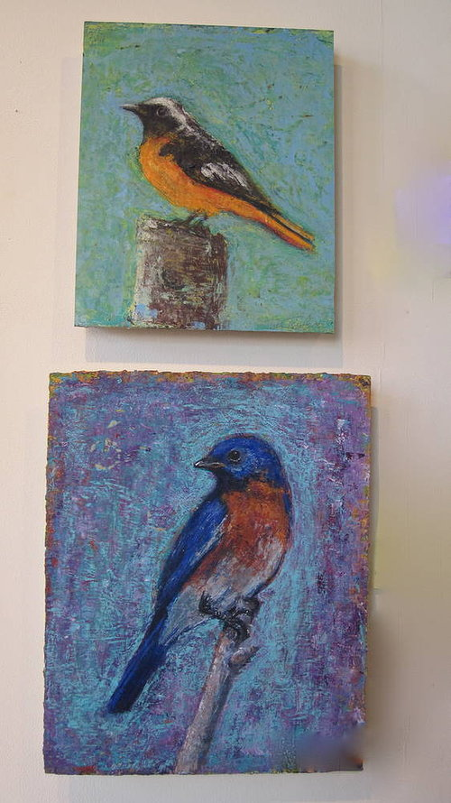 Two small paintings of birds on blue backgrounds
