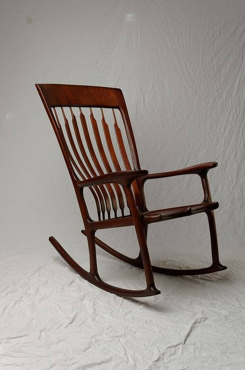 A photo of a handmade mahogany rocking chair