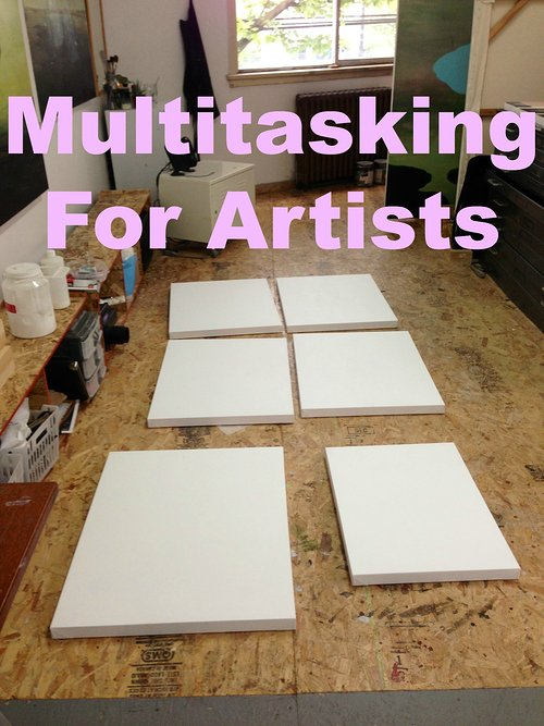 blank canvases on the studio floor