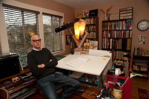 A photo of Daniel Clowes in his home studio