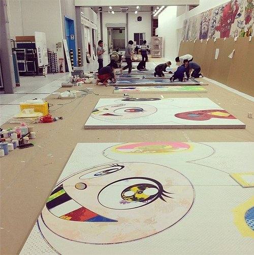 A photo of assistants making work in Takashi Murakami's studio