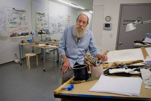 A photo of Lawrence Weiner in his home studio