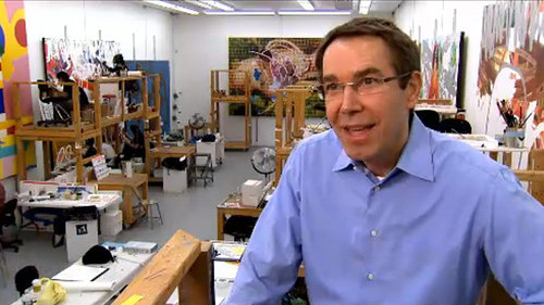 A photo of Jeff Koons sitting in his studio