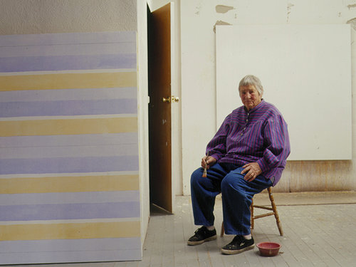 A photo of Agnes Martin sitting in her studio