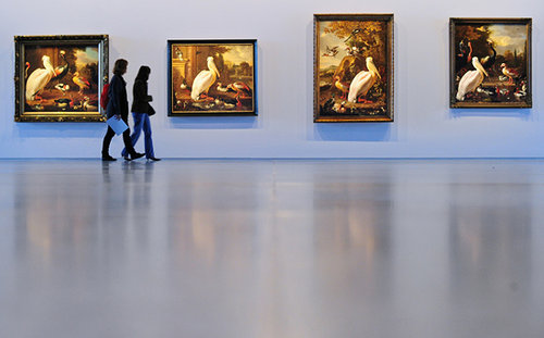 An image of four Dutch classical paintings in a gallery
