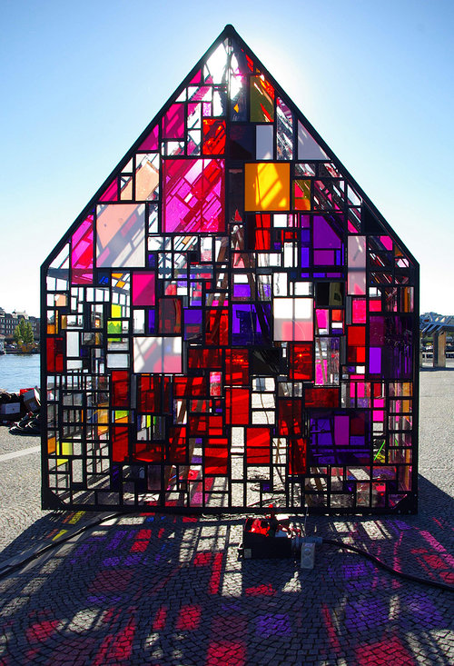 A photo of a house made of small sections of stained glass