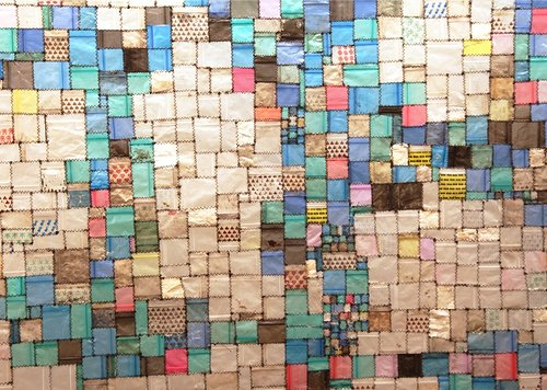 A detail photograph of a quilt made of discarded drug bags