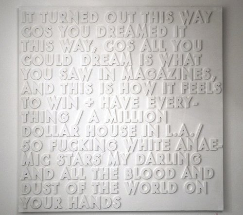 A poem molded into three-dimensional plaster