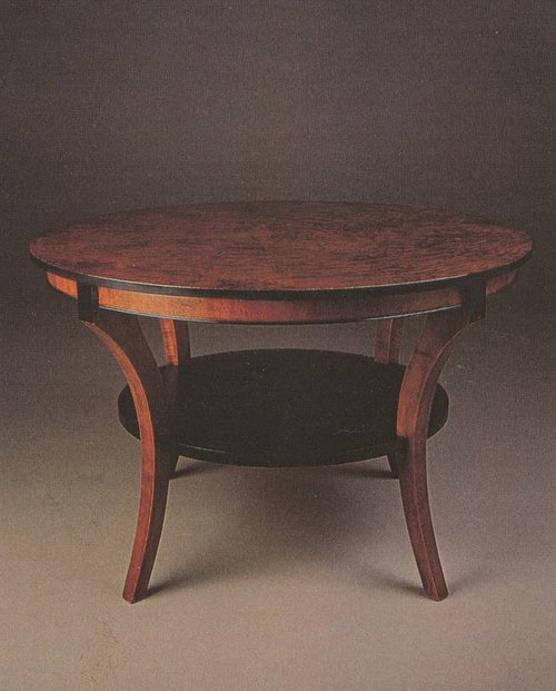 A photo of a round, custom-made dining table