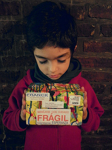 A photo of a young Argentinian boy holding a Peace Box