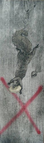 Painting of a squirrel with spray paint on a tree