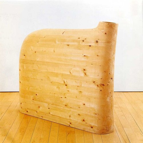 A large bulbous, smooth wooden sculpture