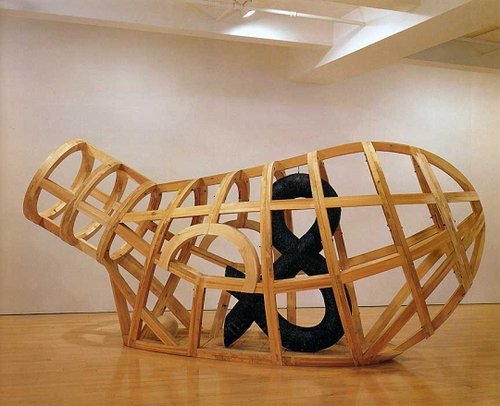 A sculpture made of wood that looks like the framework of a large vessel