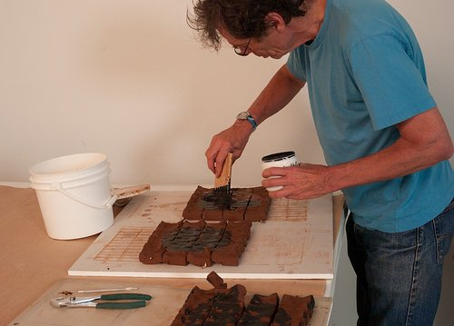 A photo of Richard Tuttle working in his art studio