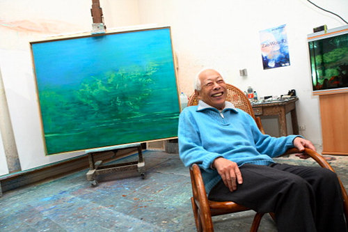 A photo of painter Zao Wou-Ki sitting in his studio