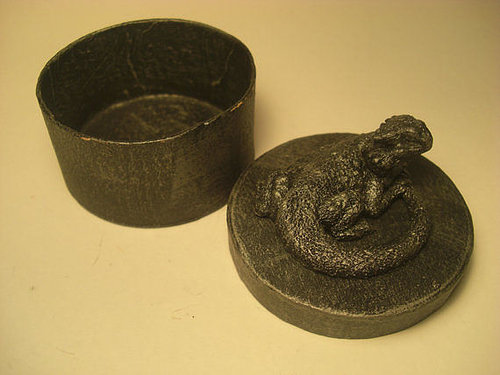 A small trinket box with a sculpted bearded dragon on top