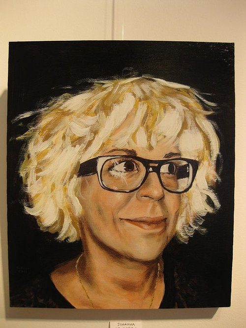 A realistic portrait of a woman with blonde hair and glasses on wood panel