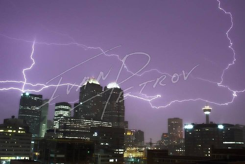 A photograph of lighting over a city skyline in Alberta