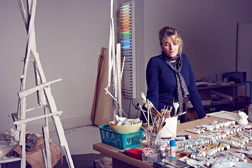 A photograph of Tracey Emin looking thoughtful in her studio