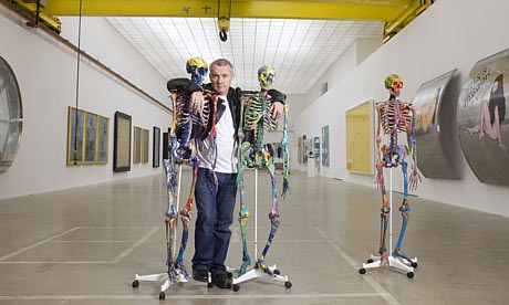 A photo of Damien Hirst in his studio in England