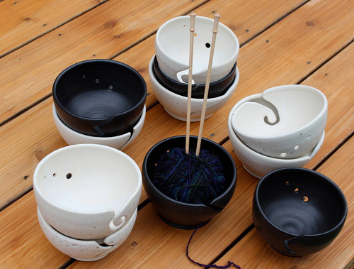 A series of ceramic bowls with built-in slots for yarn
