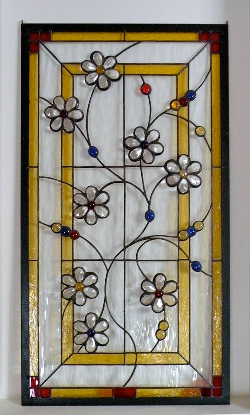 A stained glass window with flowers made of chandelier crystals
