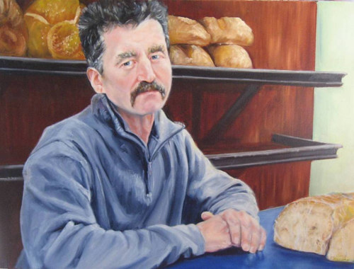 A painting of a baker standing in his shop with loaves of bread