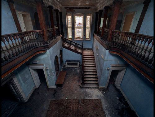 A photo of a grand hall of an abandoned house