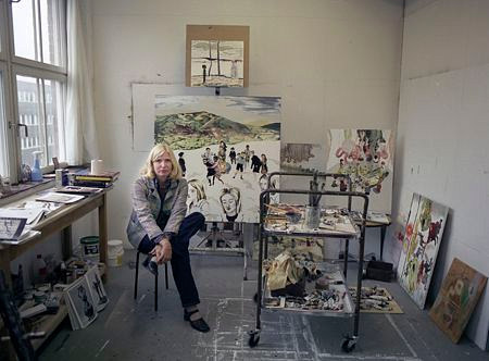 A photo of Karin Mamma Andersson sitting in her studio