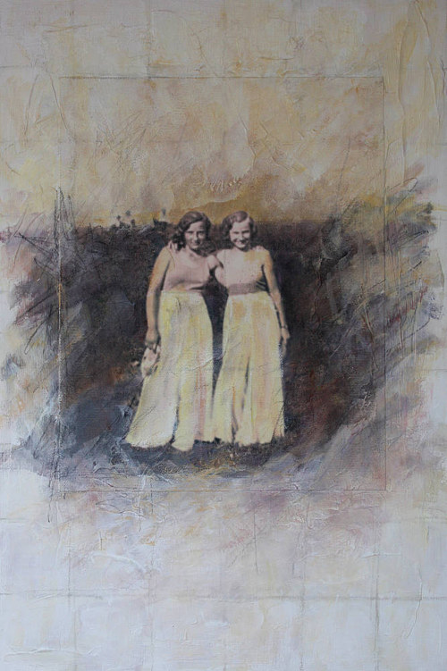 A photo of two young women laughing incorporated into a mixed media work