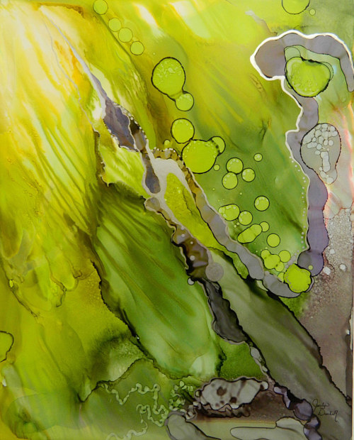 An abstract alcohol ink painting with bright green tones
