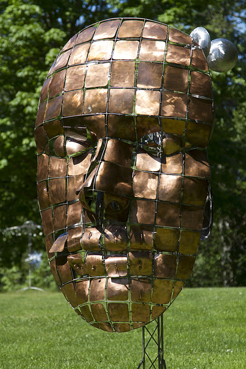 A stainless steel sculpture of a face