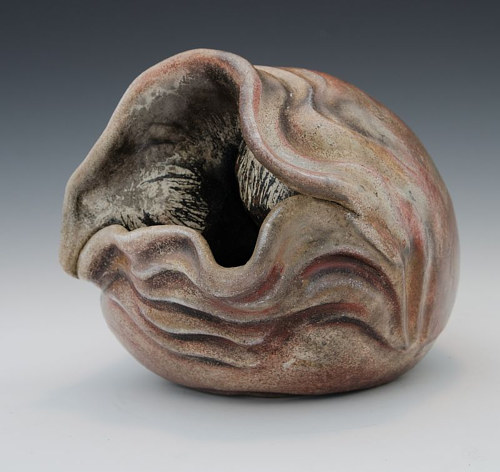 A ceramic sculpture with a clam-like appearance